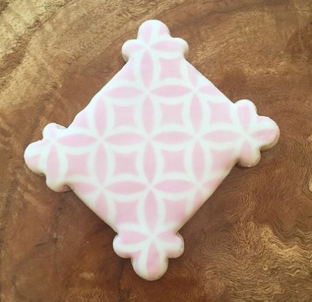 "Spanish Tiles Lattice Stencil, by The Cookie Countess, creates a lattice pattern that measures 4 1/2"" x 4 1/2"". This stencil is great for cookies, cupcakes, cakes, and more. Finished cookie by Hillary Ramos."