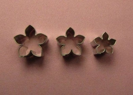 "Stephanotis Cutter Set of 3. The large Stephanotis cutter measures 1"" x 1"", the medium cutter measures 3/4"" x 3/4"", and the smallest cutter measures 5/8"" x 5/8""."