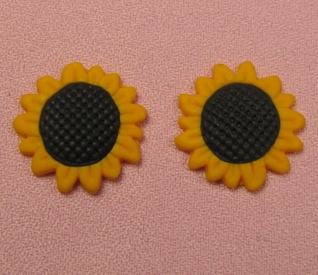 "Sunflower Pair, by Jennifer Dontz, is a 2 cavity mold that creates 2 Sunflowers of the same size. Each Sunflower measures 1"" x 1"" x 1/4""."