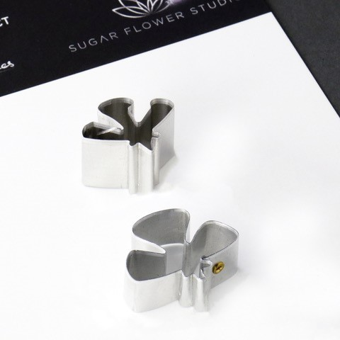 "Scabious Petal aluminium metal cutter set of 2 measurements - small petal length 1.9 cm x width 2.3 cm, large petal length 2.5 cm x width 2.9 cm. (small petal length 3/4"" x width 7/8"", large petal 1"" width 1 1/8"").  This distinctive range of Botanically Correct Products By Sugar Flower Studio are designed by master sugar artist Robert Haynes. These quality products can be used to replicate time and again, stunning life like flora in any edible or non-edible medium of your choice. The aluminium metal cutters in the Sugar Flower Studio range are perfectly matched to fit within the perimeters of each corresponding silicone veiner, giving you a time efficient and botanically correct result each time. These cutters can be used with edible mediums including sugar flower paste (SFP) gum paste, fondant, modelling chocolate and marzipan. They can also be used with non-edible modelling mediums: cold porcelain (Modena), Hearty - Artista soft, polymer clay and modelling clay. Instructions for use of products: Using the Sugar Flower Studio Hand saver, place on top of each cutter, cut out petals or leaves. Place thinned out petal or leaf shape into lightly corn-floured Sugar Flower Studio veiner. Press firmly to give a natural vein. Remove petal or leaf and allow medium to go leathery before colouring. To clean cutters, wipe with an alcohol dampened soft cloth after each use. Copyright © 2016 Sugar Flower Studio"